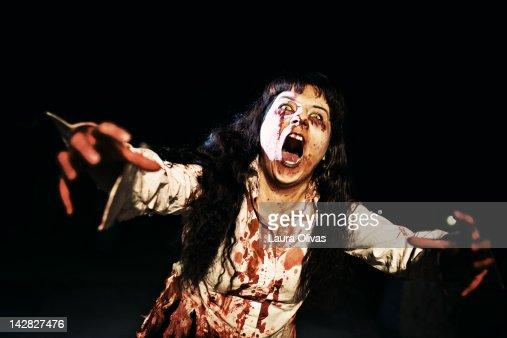 Woman zombie walks at night