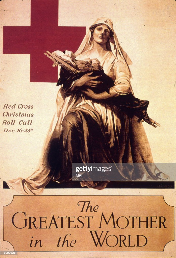A womanly figure representing the Red Cross cradles a stretcher in her arms on which lies a bandaged form. The wording reads, ' Red Cross Christmas Roll Call 16th - 23rd December. The Greatest Mother in the World'.