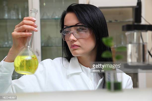 Woman-microbiologist works with liquid reagents