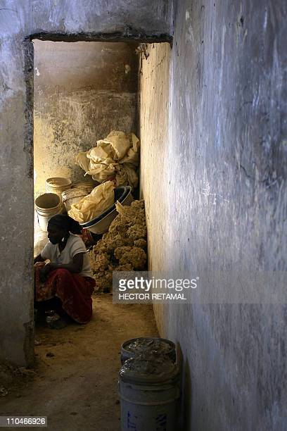GUIHAIREA womann maks mud cakes in Fort Dimanche in PortauPrince Haiti January 22 2011 A prisoner's worst fate was to be dragged off to Fort Dimanche...