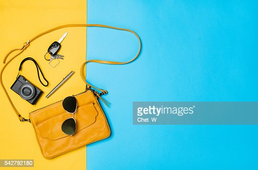 Woman's accessories lying flat on textured fabric background : Stock-Foto