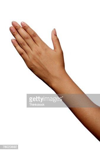 Woman's arm and hand with fingers together