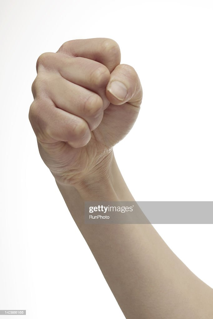 woman's arm raised with clenched fist, close-up : Stockfoto