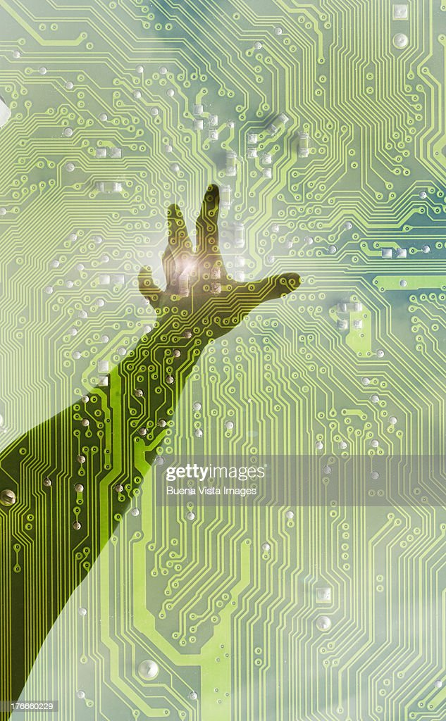 woman's arm through circuit board : Stock Photo