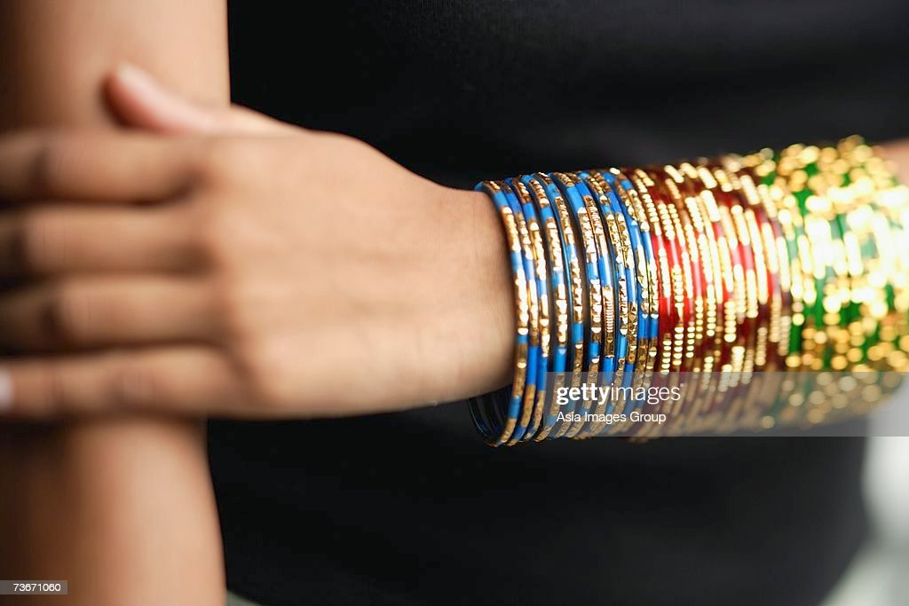 Woman's arm with colourful bangles : Stock Photo