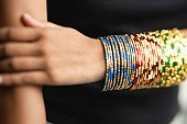 Woman's arm with colourful bangles