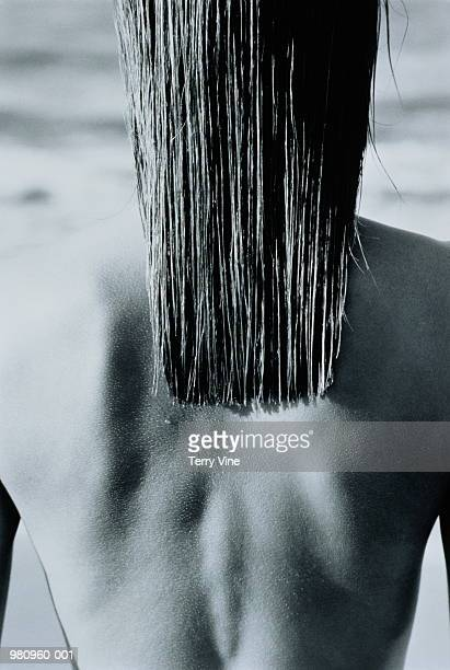 Woman's bare back with long wet hair, rear view  (B&W)
