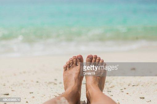 Woman's Bare Feet on the beach : Stock Photo