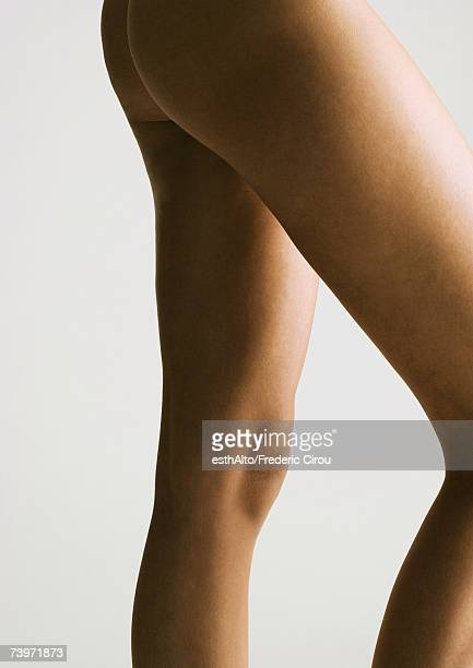 Woman's bare legs and buttocks, side view