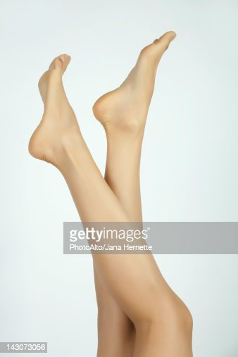 Woman's bare legs and feet, cropped