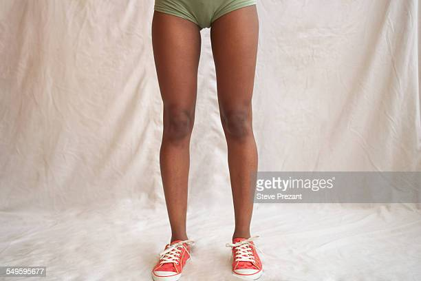 Womans Bare Legs in Sneakers