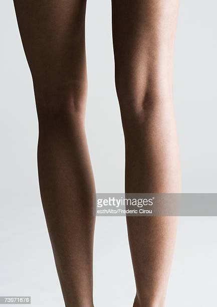 Woman's bare legs, rear view