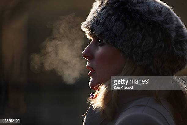 A woman's breath is backlit on a freezing morning in Regents Park on December 12 2012 in London England Forecasters have warned that the UK could...