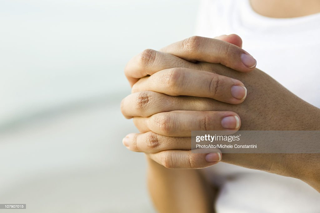 Woman's clasped hands