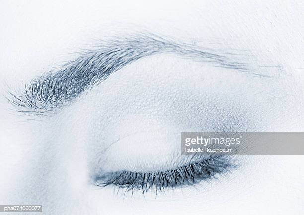 Woman's closed, made-up eye, extreme close-up, b&w