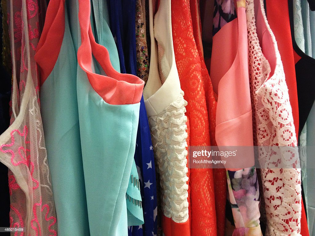 Woman's clothes hanging on rail : Stock Photo