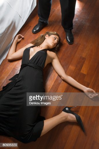 Woman's dead body on floor : Stock Photo