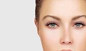 Green eyeseyes with long eyelashes.