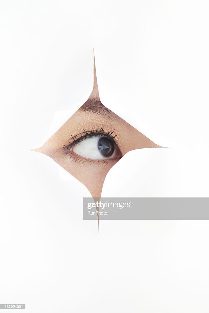 woman's eye visible through a gap : Stock Photo