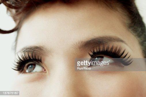 woman's eyes with false eyelashes