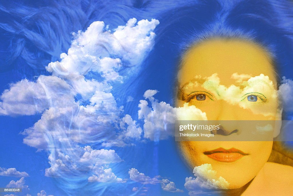 Woman's face composite with cloudy sky : Stock Photo