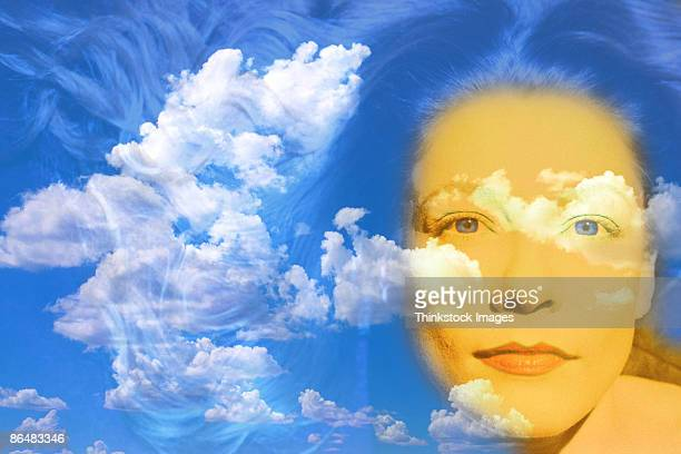 Woman's face composite with cloudy sky