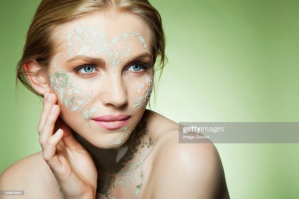 Womans face decorated with face mask : Stock Photo