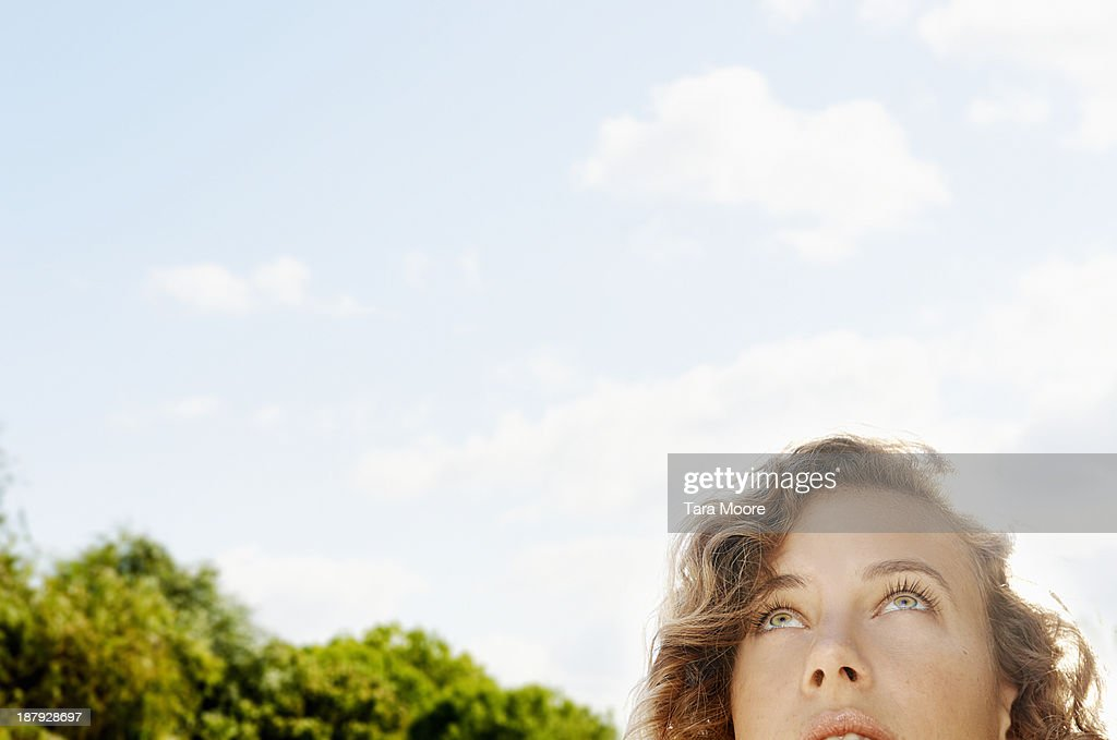 woman's face looking up to sky : Stock Photo