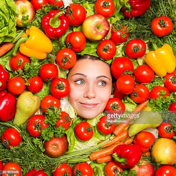 Woman's Face Surrounded With Vegetables