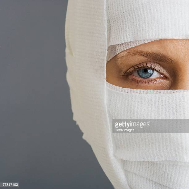 Woman's face wrapped in bandages