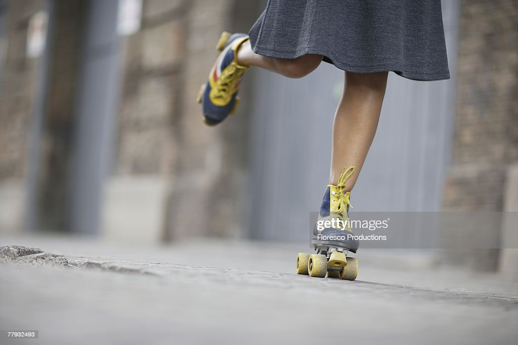 Woman's feet rollerskating : Stock Photo