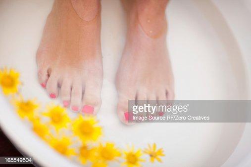 Woman's feet soaking in tub