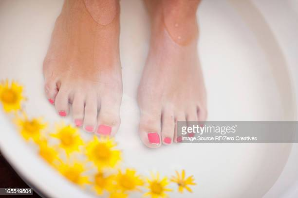Woman's feet soaking in tub