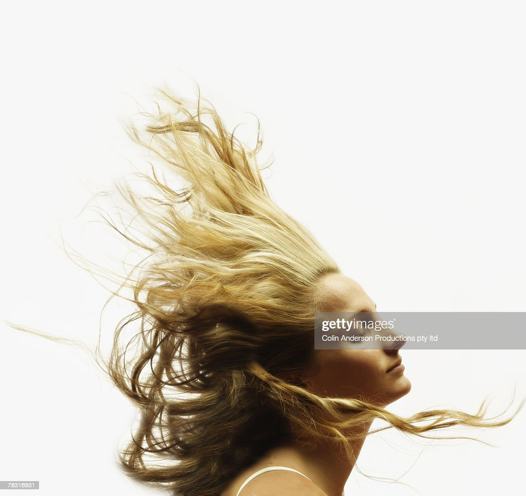 Woman's flowing blonde hair : Stock Photo