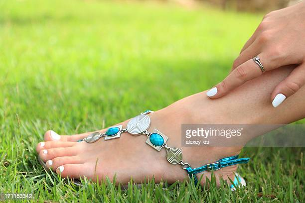 Woman's foot on green grass