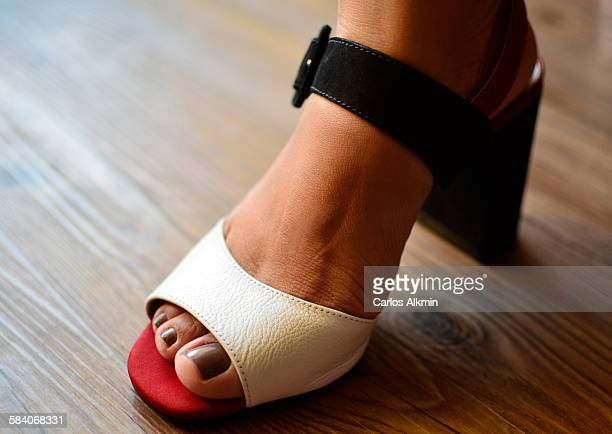 Woman's foot with painted nails in sandal