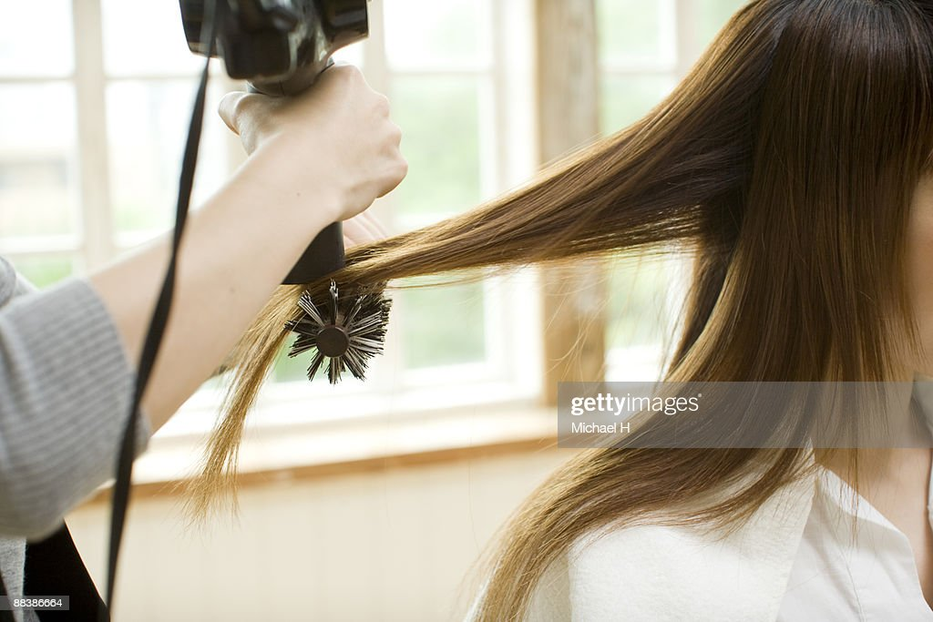Woman's hair is combed.  : Stock Photo
