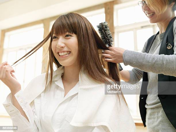 Woman's hair is combed.