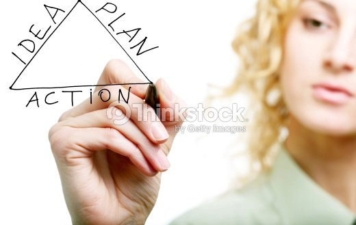 womans hand drawing triangle stock photo thinkstock