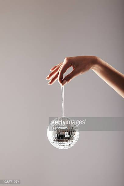 Woman's Hand Holding a Disco Ball