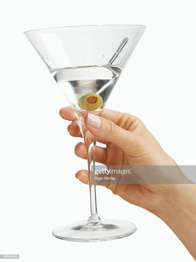 woman's hand holding a martini glass