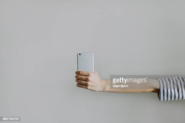 Woman's hand holding a mobile phone