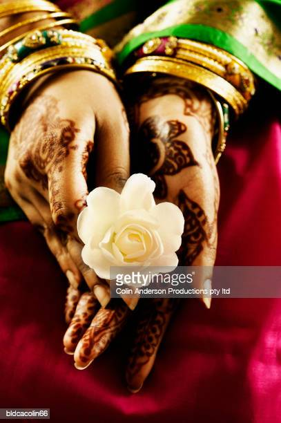 Woman's hand holding a rose