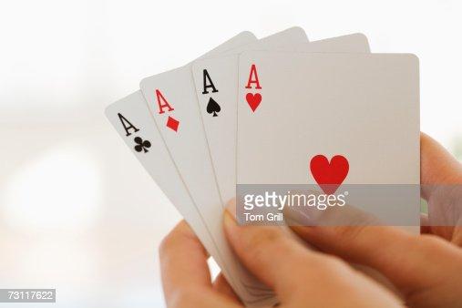 Womans hand holding four aces : Foto de stock