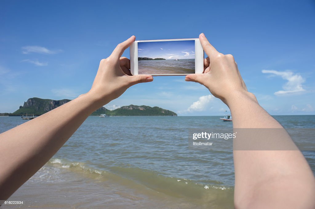 woman's hand holding smart phone,take a photo of the : Stock Photo