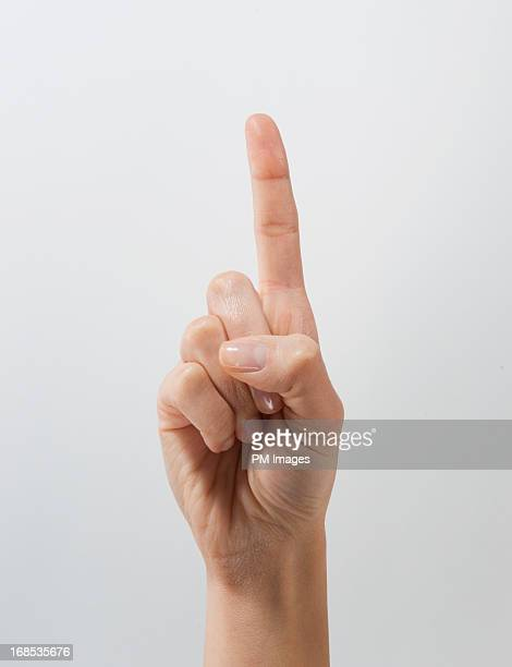 Woman's hand holding up one finger