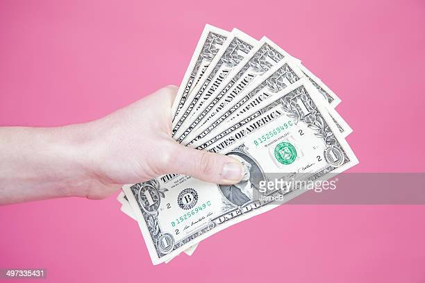 Woman's hand holding US banknotes