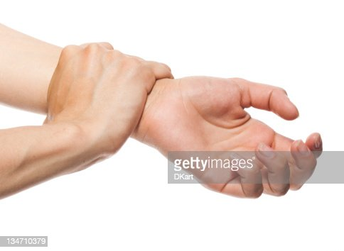 Woman's hand holding wrist of other hand