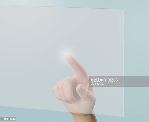 A woman's hand is touching a digital screen.