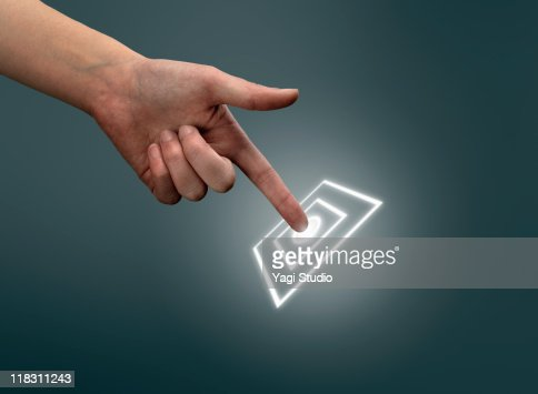 A woman's hand is touching a digital screen. : Stock Photo